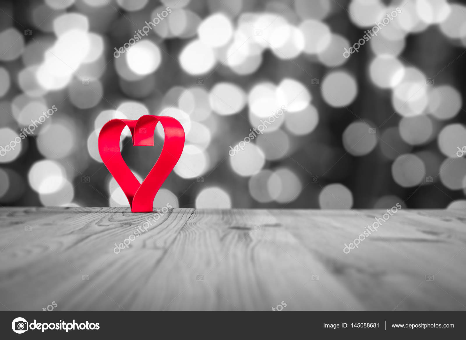 Red heart on wooden table on a whiteblack background valentines