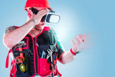 Builder or engineer enjoying virtual reality through vr gogles. Builder or computer technologies concept.