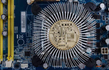 Gold bitcoin with microcircuits on a blue background. The concep