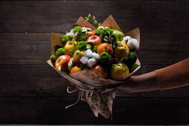 Original unusual edible bouquet of vegetables and fruits