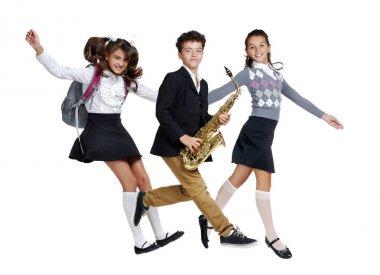 Schoolchildren  jumping high against white background all togeth