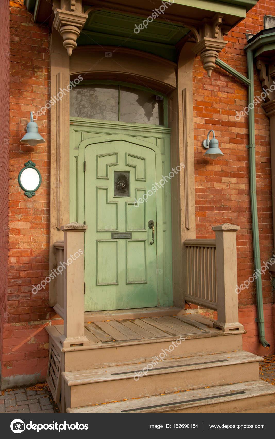 Antique Doors in Toronto, Canada — Photo by Vividrange - Green Antique Doors In Toronto, Canada — Stock Photo © Vividrange