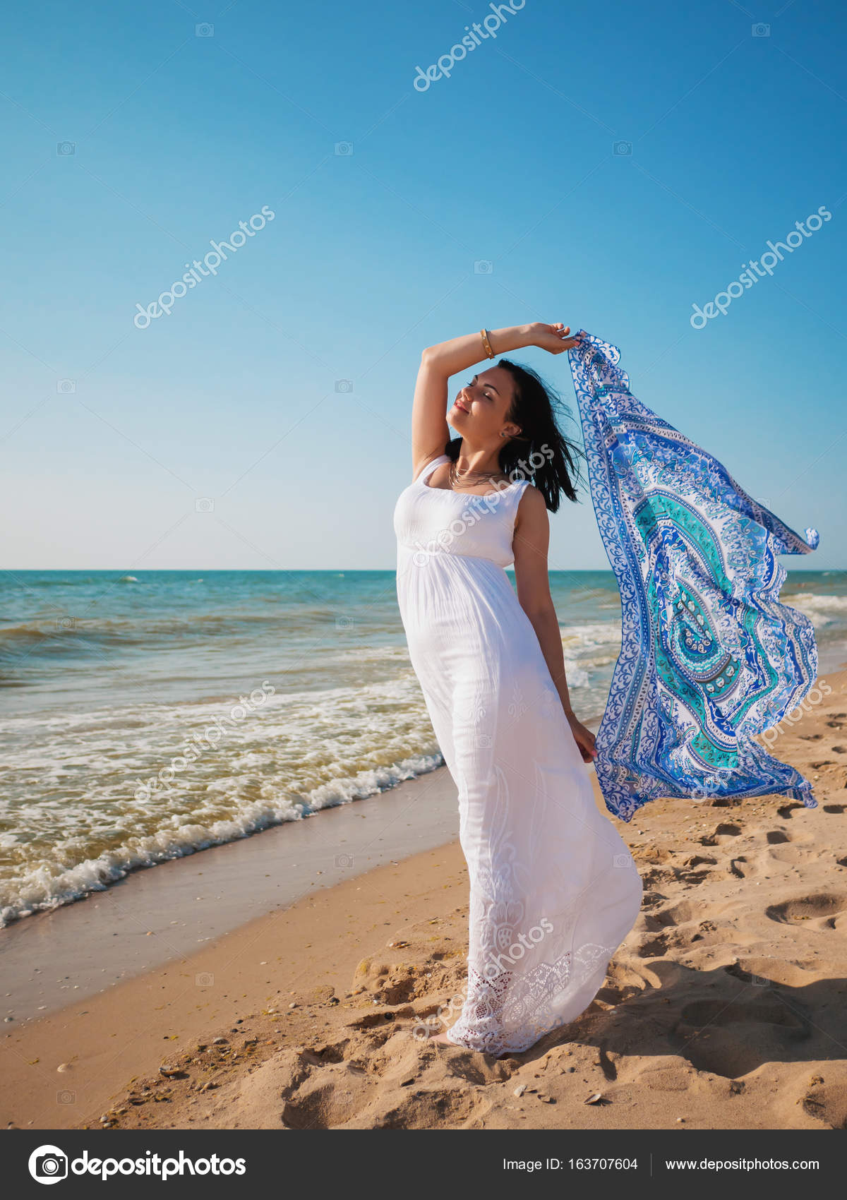 Gypsy young brunette Girl wearing white maxi long dress standing on ...