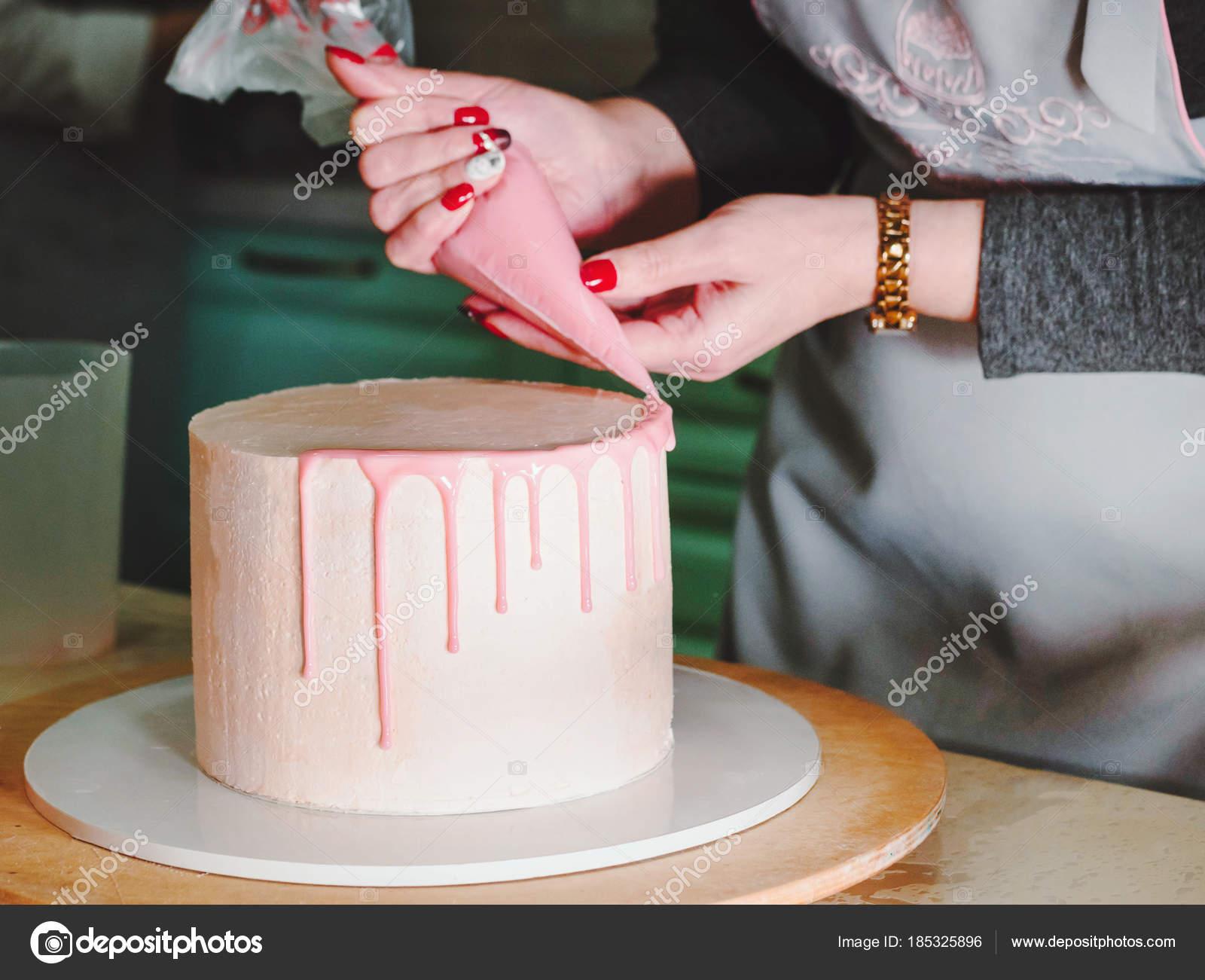 Unrecognisable woman decorating mousse glaze cake with - Mousse decoration ...