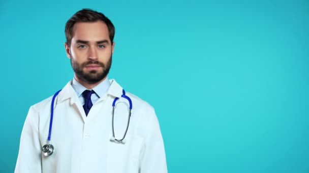 Copy space portrait of serious man in professional medical white coat shaking head like gesture of disagreement and disappointment. Doctor isolated on blue studio background.