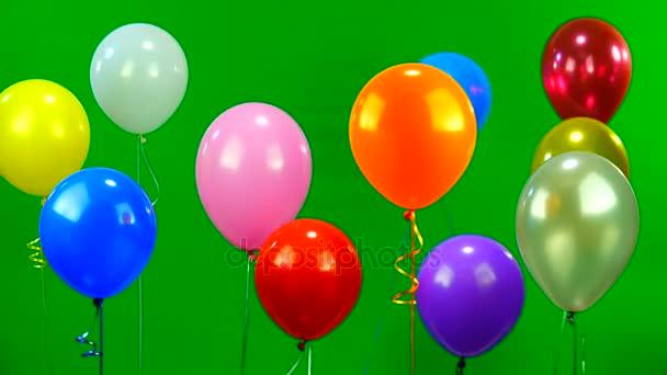 Létající balóny na zelené obrazovce