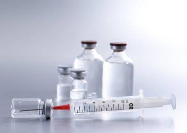Vial and syringe, studio shot