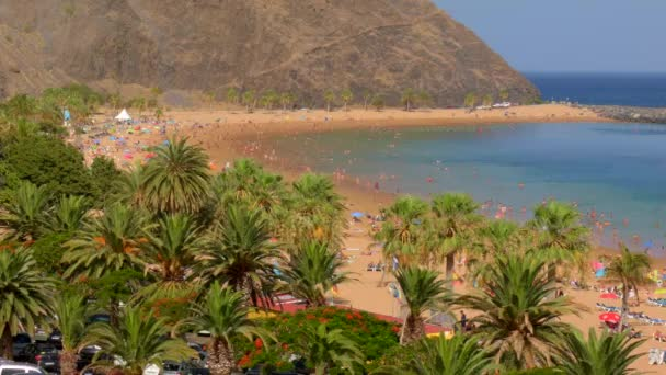 Las Teresitas beach , view from top , people on the beach , yellow sand and beautiful landscape
