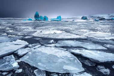 Glacial lake with icebergs, Jokulsarlon is a glacial lagoon, Vatnajokull National Park in southeastern Iceland, blue waters are dotted with icebergs from the Breidamerkurjokull Glacie stock vector