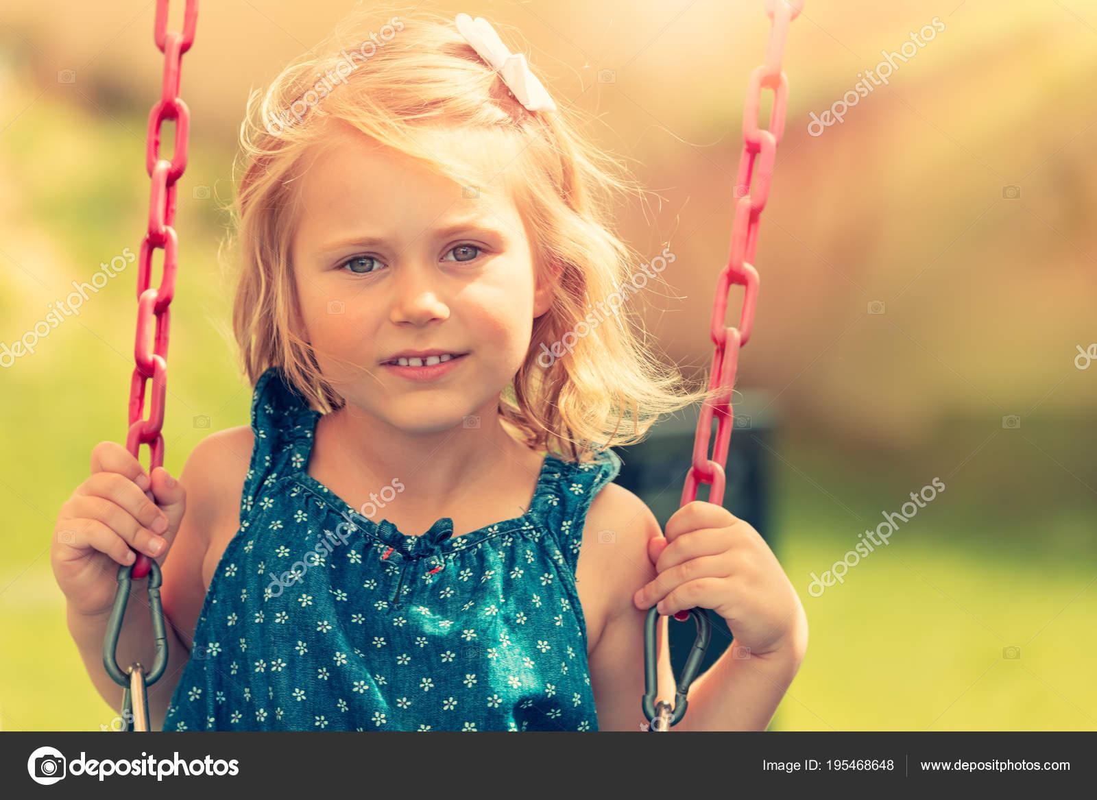 cute baby girl swinging on swing — stock photo © anna_om #195468648