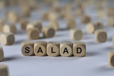 salad   cube with letters, sign with wooden cubes