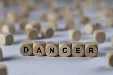 dancer   cube with letters, sign with wooden cubes