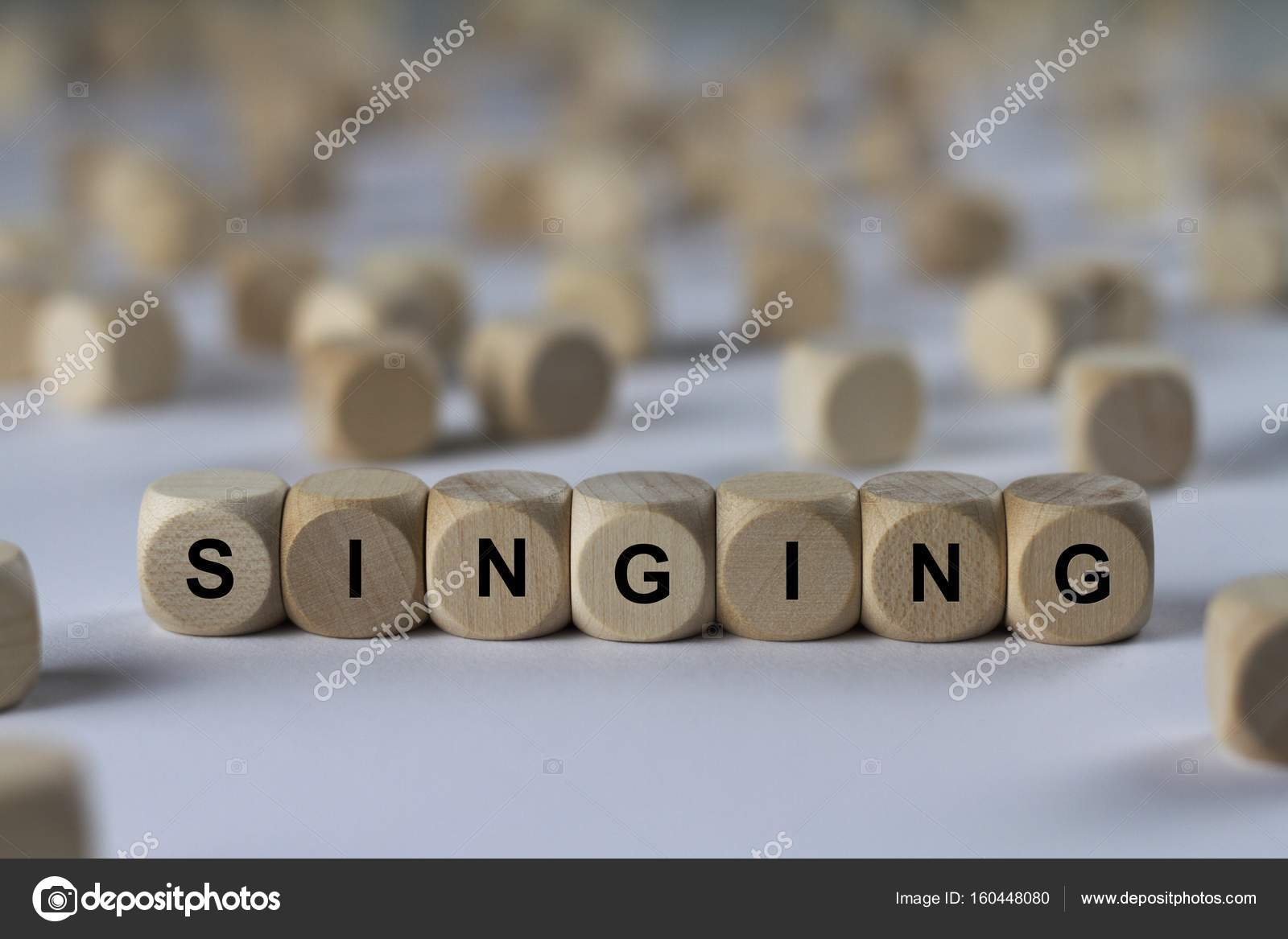 singing cube with letters sign with wooden cubes stock photo