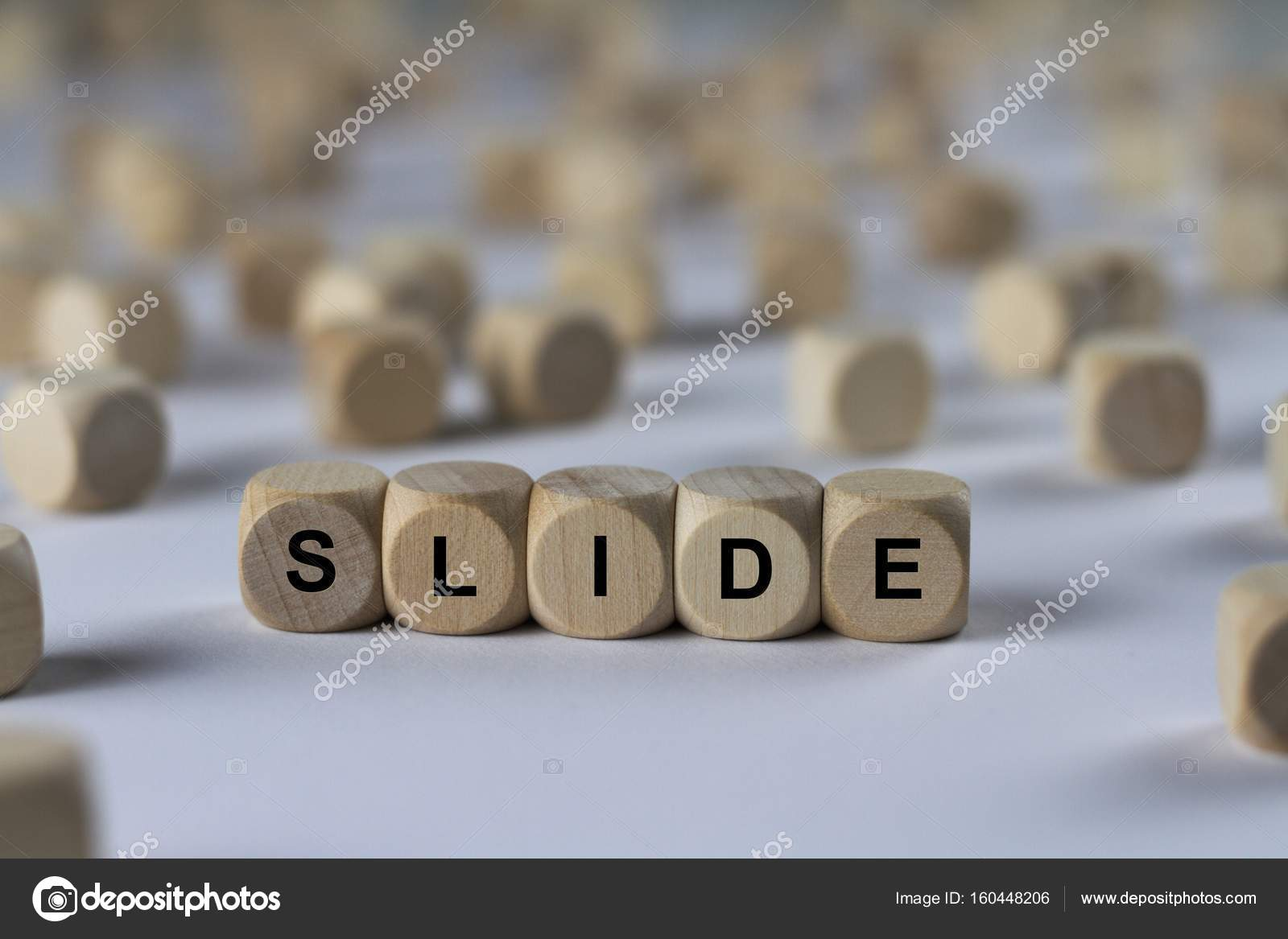 slide cube with letters sign with wooden cubes stock photo