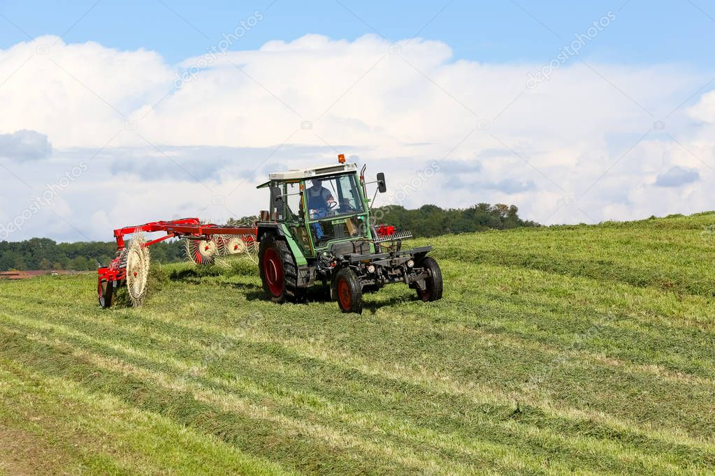 Working in agriculture using a tractor