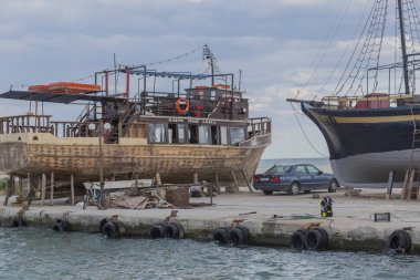 old ship repairs on the shore