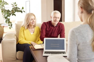 Senior couple meeting with financial consultant