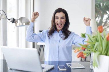 businesswoman celebrating the success.