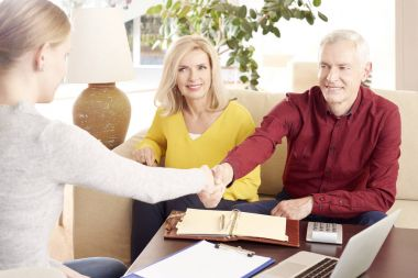 couple consulting with financial advisor