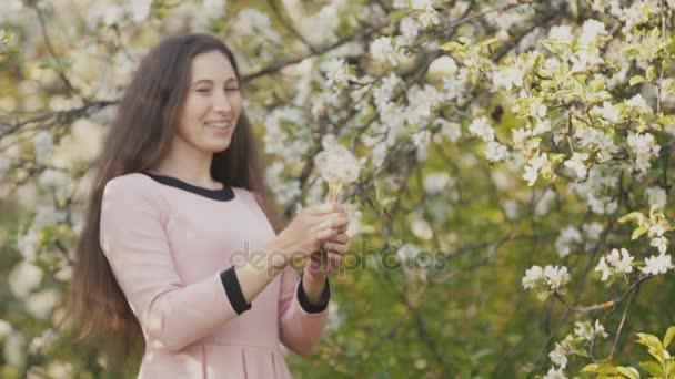 Girl blowing on dandelions