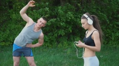 The guy does the warm-up while the girl is wearing headphones