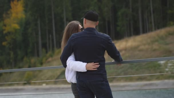 A guy with a girl walks near the lake