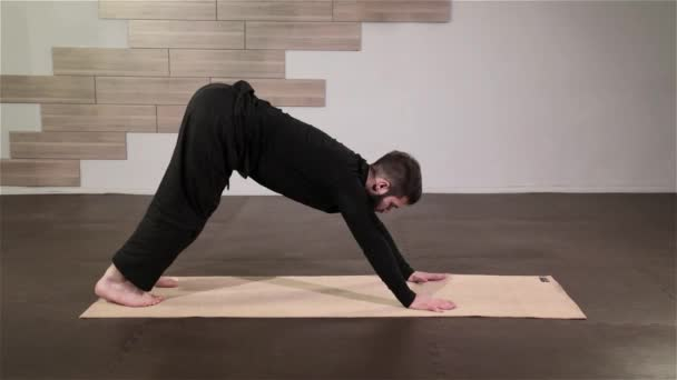Strong Man Practicing Difficult Yoga Pose Stock Video
