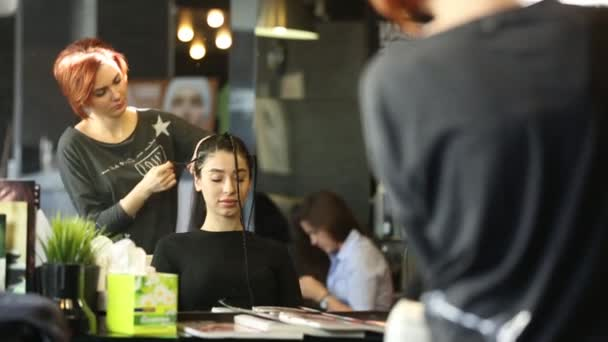 Woman Getting Hair Styled In Salon