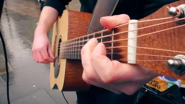 Guitarist plays guitar.