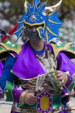 LOULE, PORTUGAL - FEB 2018: Colorful Carnival Parade festival participant on Loule city, Portugal.