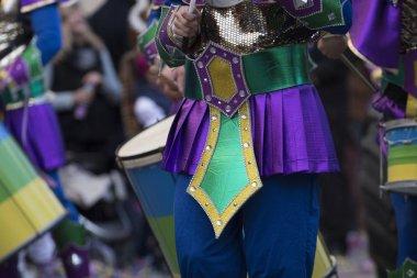 LOULE, PORTUGAL - FEB 2018: Colorful Carnival (Carnaval) Parade festival participants on Loule city, Portugal.