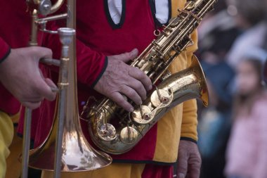 LOULE, PORTUGAL - FEB 2018: Close up view of  Carnival (Carnaval) Parade festival music band saxophone instrument.