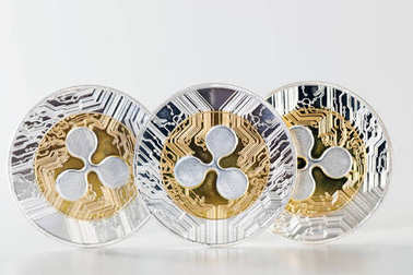 Shiny ripple coins on a white background.