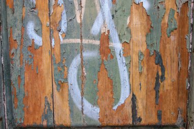 Close up view of an old wood texture with peeled paint backdrop.