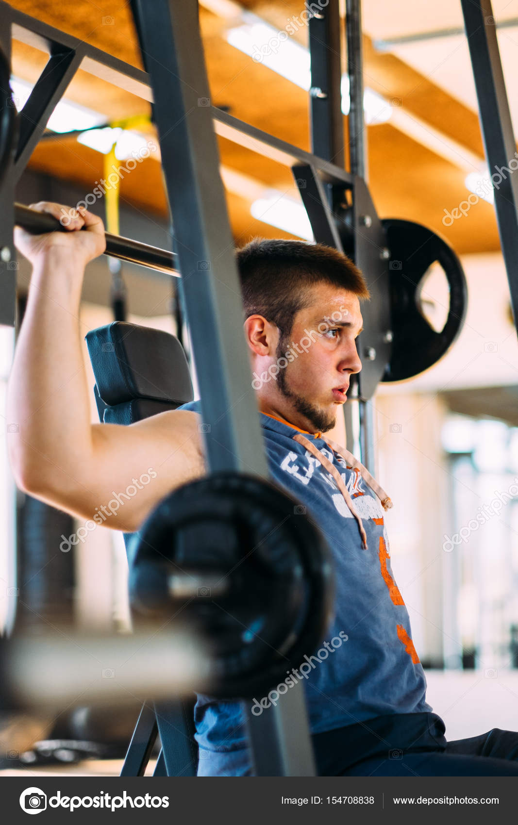 Fitness man exercising with barbell in gym  Fitness man