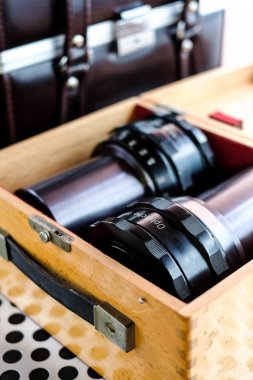 Professional projector lenses in wooden storage box