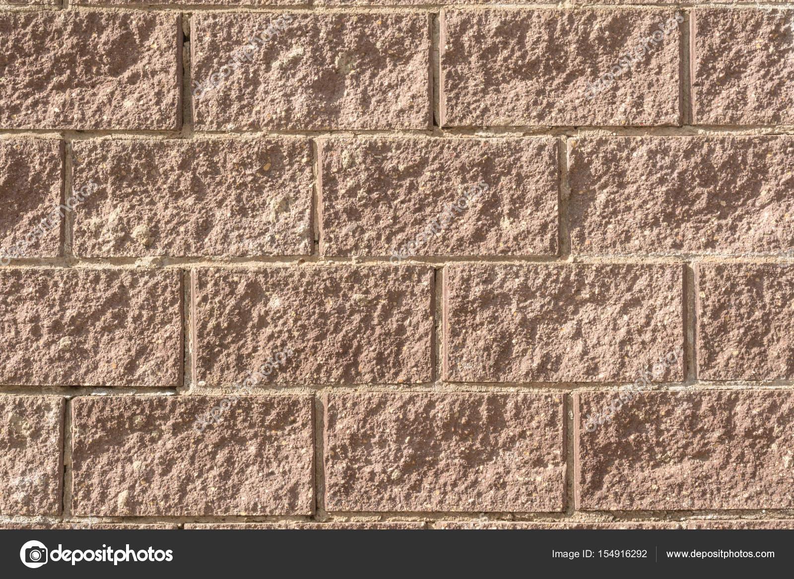 Struttura decorativa di un muro di mattoni moderno con illuminazione