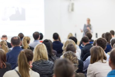 Woman giving presentation on business conference.