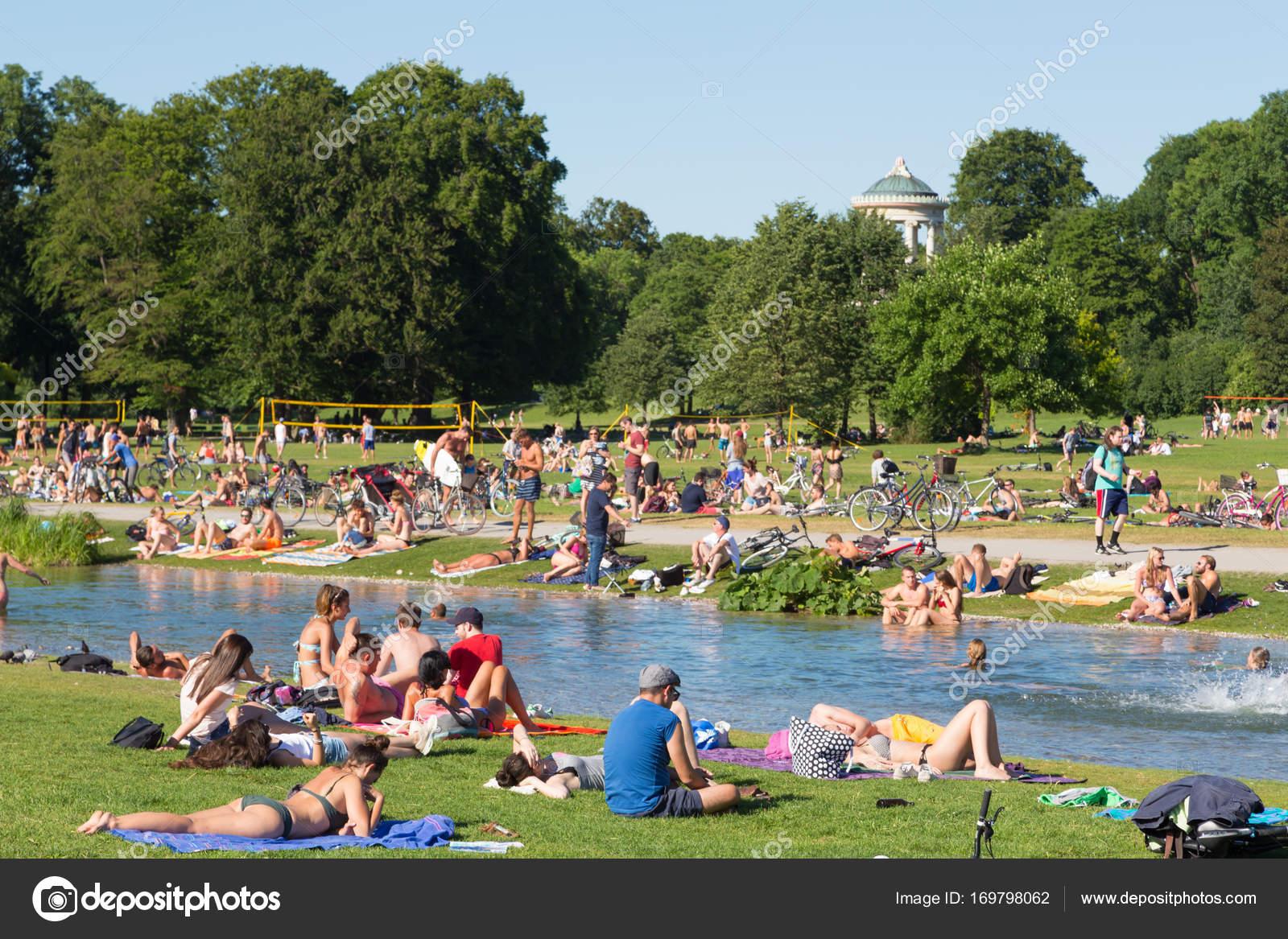 people enjoying the summer day in englischer garten city park in munich germany stock. Black Bedroom Furniture Sets. Home Design Ideas