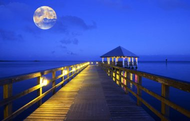 Full moon over a pier in Florida Keys