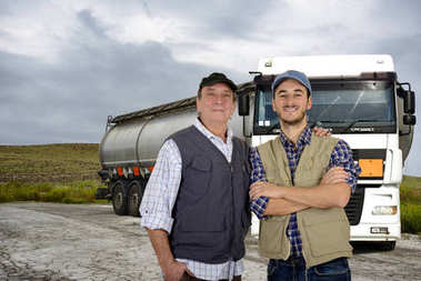 Mature and young truck drivers