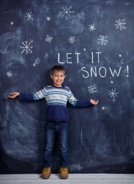 Boy with Snow in studio