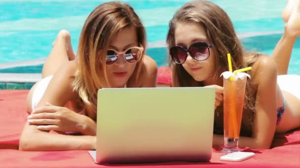 Two Young Adult Women Working On Laptop Together Stock Video
