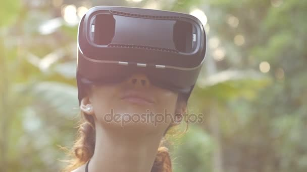woman uses a virtual reality glasses in the jungle 6 shots