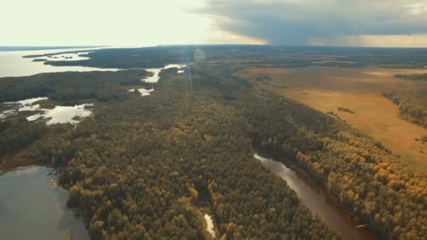 Flight over the forests and the river. Forest Valley. Autumn fields at sunset