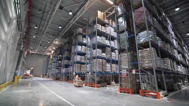 industrial warehouse with boxes forklift small cargo truck drives
