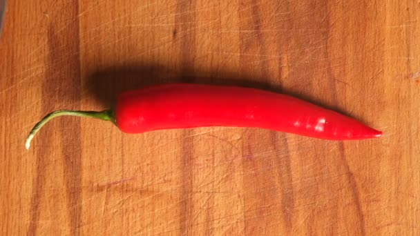 red hot pepper on cutting board. chilli pepper for cooking. top view Close-up