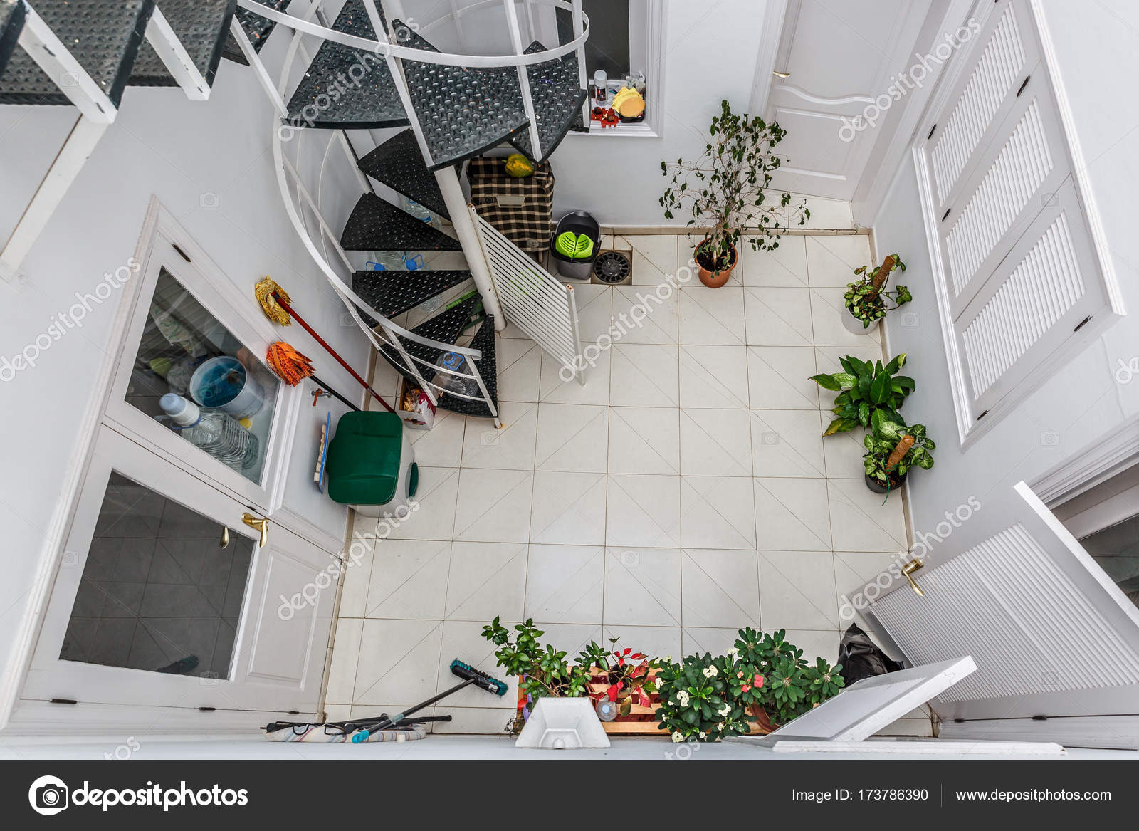 View From Above Of A Patio With Plants Mops Cubes And Stairs