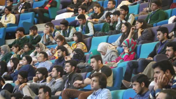 ISLAMABAD, PAKISTAN - DEC 03, 2016: Young crowd listening to motivational speakers at Learn, Create, Lead Annual Entrepreneurship Conference at Jinnah Convention Center in Islamabad, Pakistan