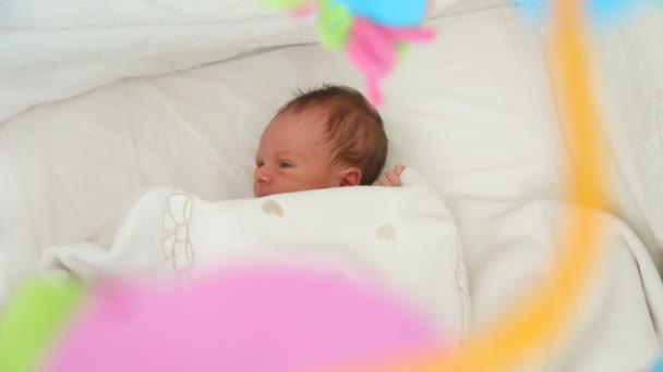 Closeup Shot Of Cute 1 Months Old Baby Lying Under Blanket In Crib